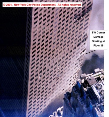 "This photo, showing the western face of WTC 7, is featured in the April 5, 2005 ""NIST Response to the World Trade Center Disaster: Part IIC – WTC7 Collapse"" (pg. 16). Note the damage to the south-west corner of the building, as well as the amount of broken windows on the western wall."