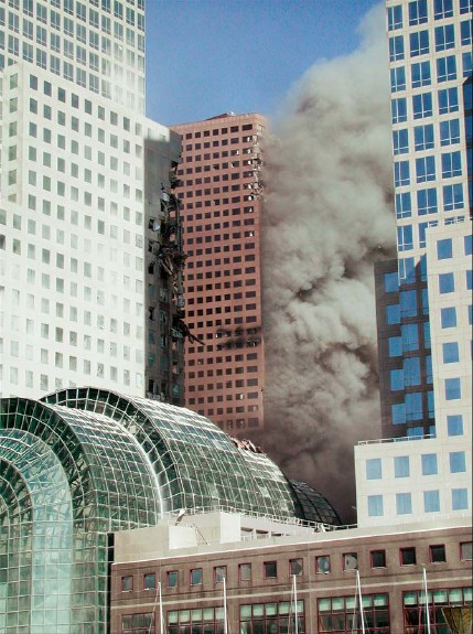 In this FEMA report photo (figure 5-17), notice that dark smoke is emanating from a number of windows on the south face of WTC7, obscuring the extent of fire and/or debris damage it has sustained. Curiously, while smoke appears to be emanating from the south face of just about every south-west corner office in view, only a few windows on the western face of the same corner offices are emitting any smoke at all.