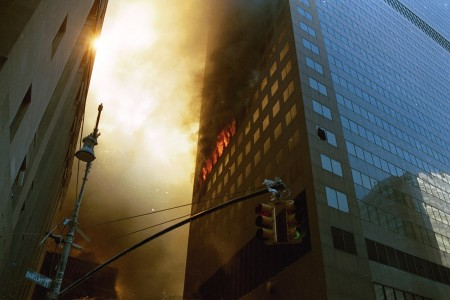 The lower portion of eastern face of WTC 7, as seen from the corner of Barclay Street & West Broadway. There is a fire on the 12th floor that spans across seven to eight windows.