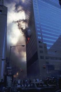 Another wide-angle view of the eastern face of WTC 7 on fire.
