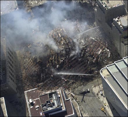 Notice how the four outer walls of WTC7 have neatly fallen/folded into and on top of the rest of the pile of ruins without significantly damaging any of the adjacent building.