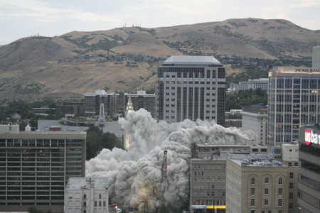 Note the presence of a high-energy dust cloud as the building is imploded.