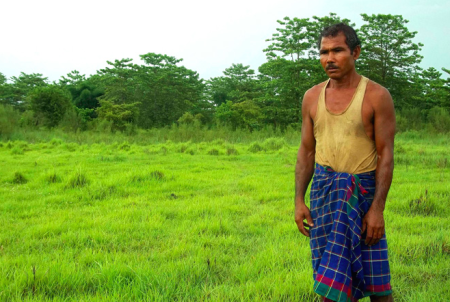 "Jadav ""Molai"" Payeng stands among the fruit of his life-long reforestation effort in India"