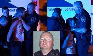 Officer Frank Phillips chokes suspect Jarod Dotson into unconsciousness