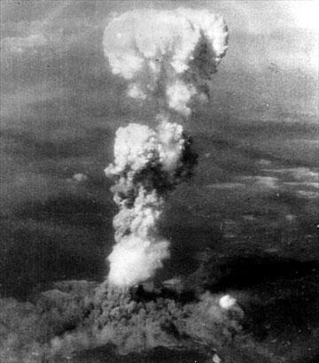 A mushroom cloud rising over Hiroshima, Japan