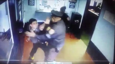 Kevin Rosado is beaten by Officer Robinson as he attempts to leave Ward Island Shelter