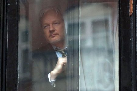 Wikileaks founder Julian Assange, looking out the window from the Ecuadorian embassy, in London, England, where he is staying