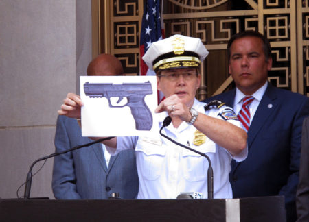 Columbus Police Chief Kim Jacobs holds up a photo showing the type of BB gun that police say 13-year-old Tyre King pulled from his waistband just before he was shot and killed by police