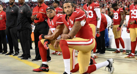 Colin Kaepernick, of the San Francisco 49ers, kneeling during the National Anthem, in protest of police brutality and racism